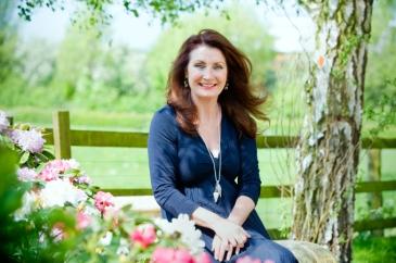 Adrienne in garden. (landscape)